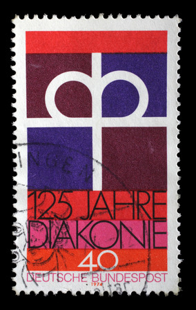 protestant: Stamp printed in the Germany dedicated to 125th anniversary of the Diaconal Association of the German Protestant Church, circa 1974.