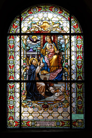 Virgin Mary with baby Jesus and Saint Dominic, stained glass window in the Parish Church of the Visitation of the Virgin Mary in Zagreb, Croatia Editorial