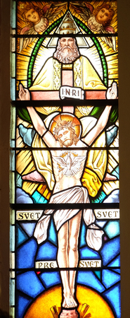Holy Trinity, stained glass window in the parish church of the Holy Trinity in Krasic, Croatia Editorial