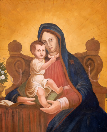fasade: Virgin Mary with baby Jesus, painting on house fasade in Zagreb, Croatia Editorial