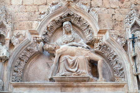 Statue of Our Lady of Sorrow on the portal of the Franciscan church of the Friars Minor in Dubrovnik, Croatia