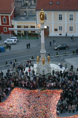 beatification: Funeral Mass for Pope John Paul II, people who did not fit into the cathedral standing in front of it and light candles for the Pope on April 04, 2005 in Zagreb, Croatia Editorial