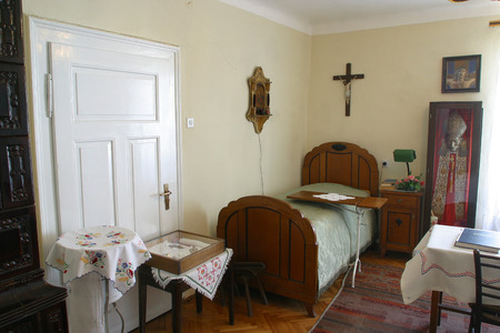 blessed trinity: Room of the Blessed Alojzije Stepinac where he had lived during his detention in the rectory in Krasic, Croatia on May 15, 2012
