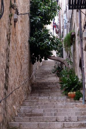 Narrow street inside Dubrovnik old town, Croatia Stock Photo