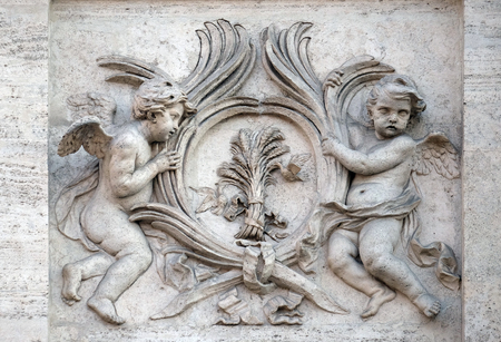 martyrdom: Angels with symbols of martyrdom on the portal of Sant Andrea della Valle Church in Rome, Italy on September 01, 2016. Stock Photo