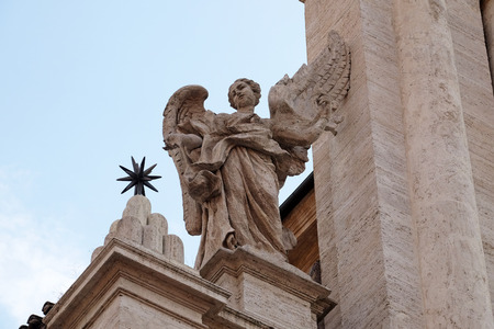 Angel on the portal of Sant Andrea della Valle Church in Rome, Italy Stock Photo