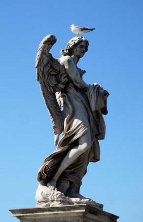 religious clothing: Statue of Angel with the Garment and Dice by Paolo Naldini, Ponte Sant Angelo in Rome, Italy