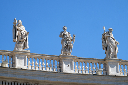St. Romuald, Joseph and Peter Nolasco, fragment of colonnade of St. Peters Basilica. Papal Basilica of St. Peter in Vatican, Rome, Italy