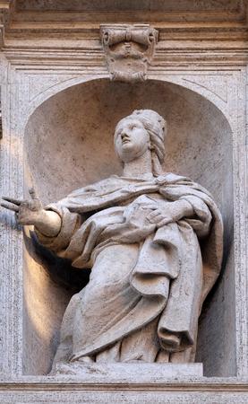 Saint Jeanne de Valois statue on the facade of Chiesa di San Luigi dei Francesi - Church of St Louis of the French, Rome, Italy