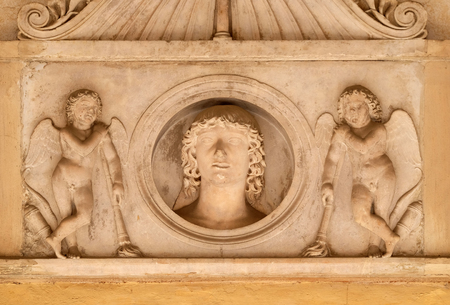 bass relief: Young man of the Colonna family, flanked by a pair of cupids with downturned torches, bass relief in portico of church dei Santi XII Apostoli in Rome, Italy
