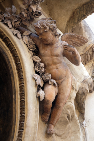 Statue of Angel on the facade of a palace in Rome, Italy Editorial
