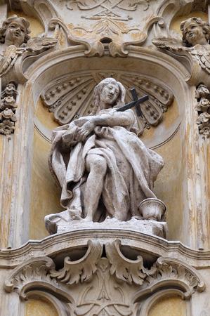 Statue of Saint Mary Magdalen on facade of Santa Maria Maddalena Church in Rome, Italy