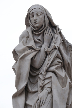 Statue of Saint Catherine of Siena near Sant Angelo Castle in Rome, Italy