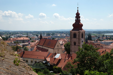 Roofs of old city center and Saint George church in Ptuj, town on the Drava River banks, Lower Styria Region, Slovenia