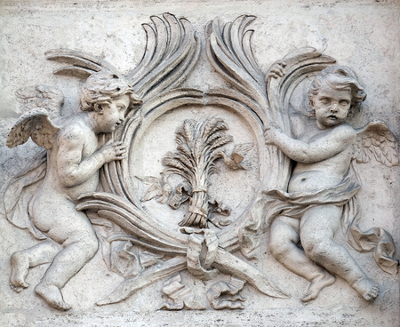 Angels with symbols of martyrdom on the portal of Sant Andrea della Valle Church in Rome, Italy