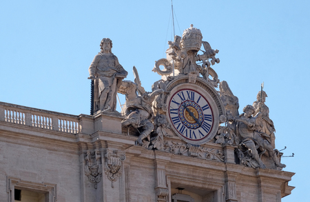 One of the giant clocks on the St. Peters facade. Two clocks were added in 1786-1790 by Giuseppe Valadier. Papal Basilica of St. Peter in Vatican, Rome, Italy Stock Photo