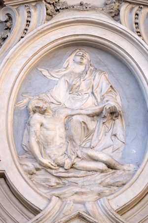 bass relief: Our Lady of Sorrows, bass relief on the facade of Sant Andrea de Urso church in Rome, Italy Stock Photo