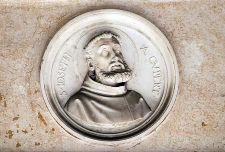 bass relief: Saint Joseph of Cupertino, bass relief in portico of church dei Santi XII Apostoli in Rome, Italy Stock Photo