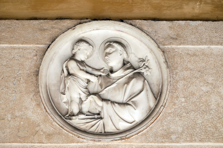 bass relief: Saint Anthony of Padua bass relief in portico of church dei Santi XII Apostoli in Rome, Italy Editorial