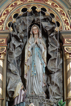Our Lady of Lourdes statue on the altar in Parish Church of Saint Roch in Kratecko, Croatia Stock Photo