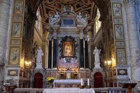 The main altar in Church of Santa Maria del Popolo, Rome, Italy