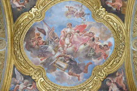 The fresco of virtue Charity on the little cupola of side nave in Basilica dei Santi Ambrogio e Carlo al Corso by Pio Paolini from (1678 - 81), Rome, Italy