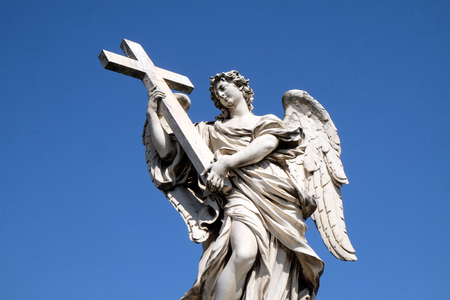 Statue of Angel with the Cross by Ercole Ferrata, Ponte Sant Angelo in Rome, Italy