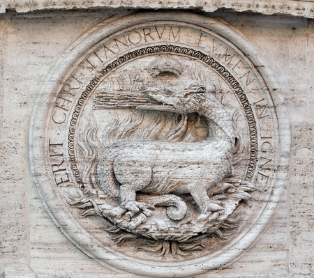 bass relief: Heraldic salamanders on the facade of Chiesa di San Luigi dei Francesi - Church of St Louis of the French, Rome, Italy