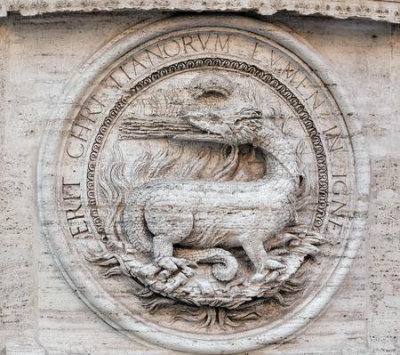 Heraldic salamanders on the facade of Chiesa di San Luigi dei Francesi - Church of St Louis of the French, Rome, Italy