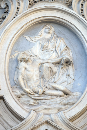 Our Lady of Sorrows, bass relief on the facade of Sant Andrea de Urso church in Rome, Italy Stock Photo