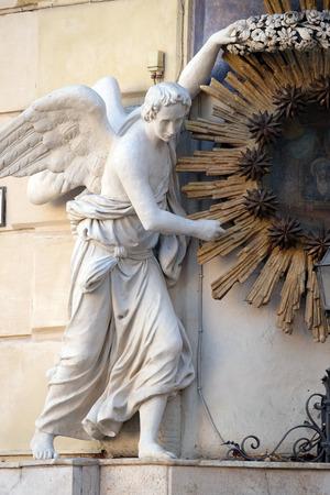 angels fountain: Angel, Madonna dellArchetto, Shrine by Virgilio Vespignani, Palazzo Castellani, Piazza di Trevi in Rome, Italy Stock Photo
