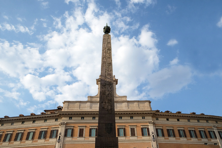 Palazzo Montecitorio, seat of the Italian Chamber of Deputies with the obelisk of Augustus in Rome, Italy