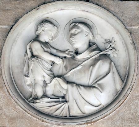 Saint Anthony of Padua bass relief in portico of church dei Santi XII Apostoli in Rome, Italy Reklamní fotografie
