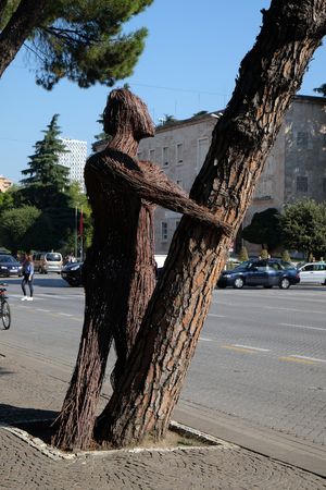 Statue on boulevard Bulevardi Deshmoret e Kombit in Tirana, Albania Editorial