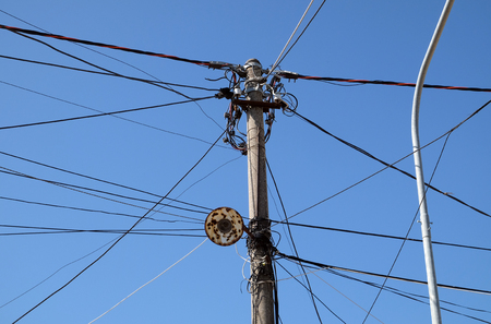 A tangle of electricity and communications cables, television aerials in Kavaje, Albania