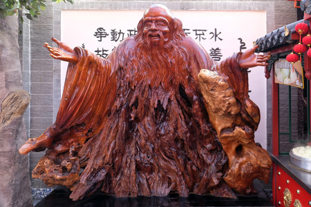 Statue on pedestal of Chinese wise man Confucius. He was a 5th century BC teacher, politician and philosopher and is widely revered across China Stock Photo