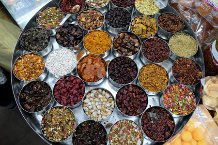 Different spices and herbs in metal bowls on a street market in Kolkata, West Bengal, India.