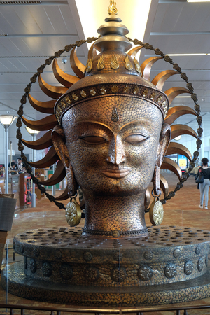 Surya, the resplendent one by Satish Gupta, the big golden statue in international Airport of Delhi. Indira Gandhi International Airport is the 32th busiest in the world. Stock Photo