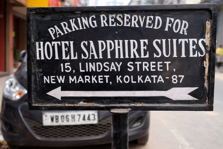 Parking banner of the hotel Sapphire Suites on New Market in Kolkata, India