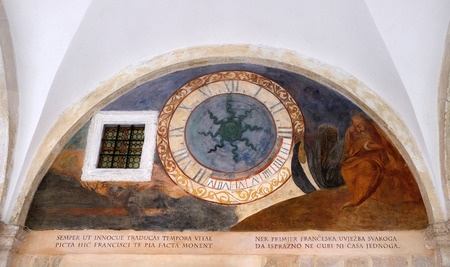 Clock in the cloister of the Franciscan monastery of the Friars Minor in Dubrovnik, Croatia Editorial