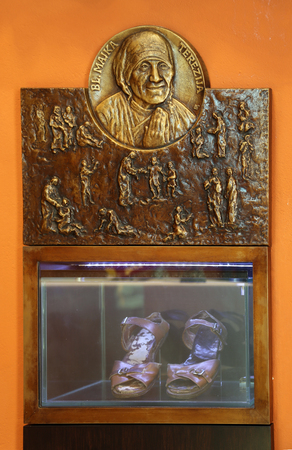 Bas relief with scenes from the life of Saint Mother Teresa of Calcutta and her sandals exposed in Chapel of Saint Dismas in Zagreb, Croatia
