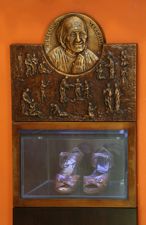 Bass relief with scenes from the life of Saint Mother Teresa of Calcutta and her sandals exposed in Chapel of Saint Dismas in Zagreb, Croatia Editorial