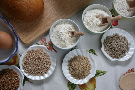 Ingredients for whole grain healthy bread, whole wheat flour, wheat germ and eggs Stock Photo
