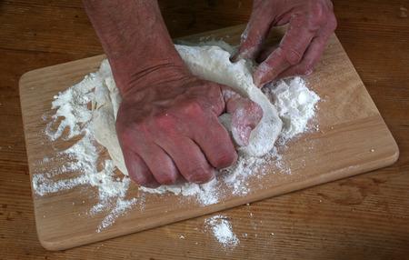 Baker preparing some dough ready to bake some bread