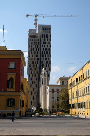 Orthodox Cathedral is overshadowed by new high-rise construction, Tirana, Albania Editorial