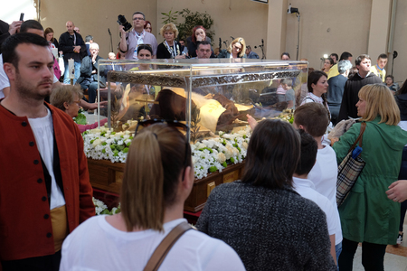 Worshippers gather to look at the relics of St. Leopold Mandic in the parish Church of Saint Leopold Mandic, Zagreb, Croatia on April 16, 2016. Editoriali