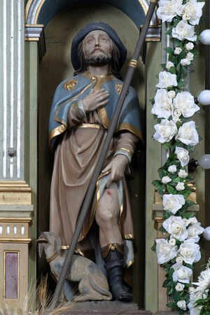 Saint Roch statue at the altar in the Parish Church of Saint Joseph in Sisljavic, Croatia Stock Photo