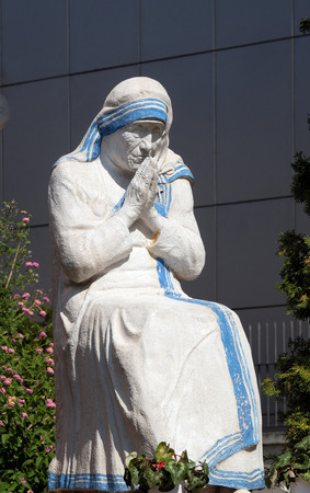Mother Teresa statue in front St Pauls Cathedral in Tirana, Albania