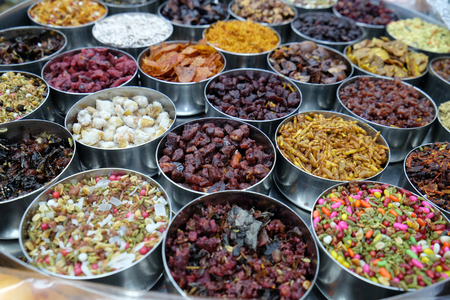 Different spices and herbs in metal bowls on a street market in Kolkata, West Bengal, India Stock Photo