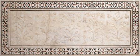 Mughal stone art on the facade of the Taj Mahal (Crown of Palaces), an ivory-white marble mausoleum on the south bank of the Yamuna river in Agra, Uttar Pradesh, India Stock Photo